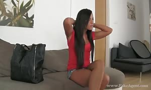Long-haired brown haired in shorts demonstrating her very bangable shape