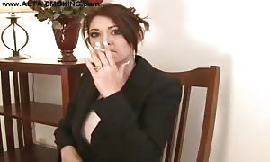 female domme is smoking her lengthy cigarette so freaking attractive