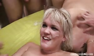 blonde is gulping delicious loads of horny jizz in the gang fuck vid