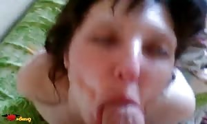 juicy brown haired is wanking his rock hard penis in her mouth