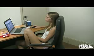 Tanned office female Meggan Powers is tugging it after a rock hard workday