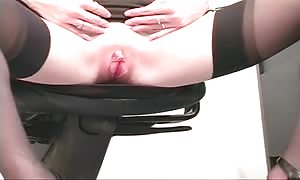 brown haired honey with small pink vag fingers herself at office