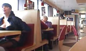 huge-boobed stunner flashing in a restaurant