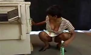 Indian cleaning woman drilled