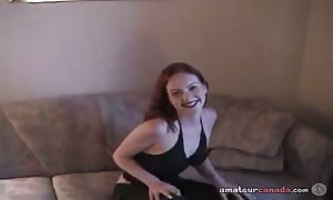 Spicy red haired woman fucks her accurate twat in the bedroom