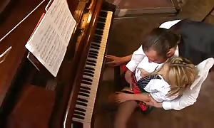 Music instructor bangs the piano pupil