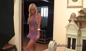 trendy busty blonde poses in a attractive dress by Alluring Vixens