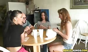 An outstanding double deep-throat mouth-fuck by two horny women in the kitchen