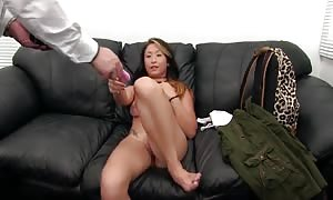 oriental bombshell is giving a awesome head in the close-up video clip